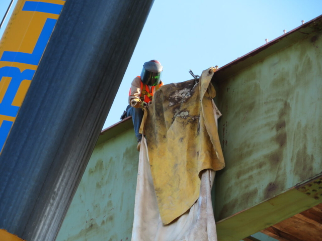 Preparing to cut the top flange of the second approach girder