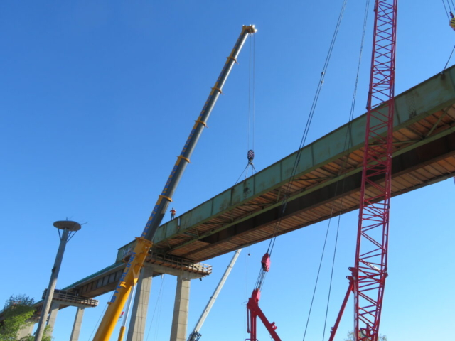 Preparing to lower the second approach girder