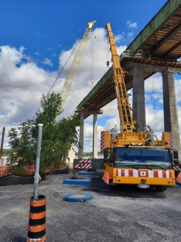 200 and 300-ton cranes hooked up to the drop-in girder in preparation for removal
