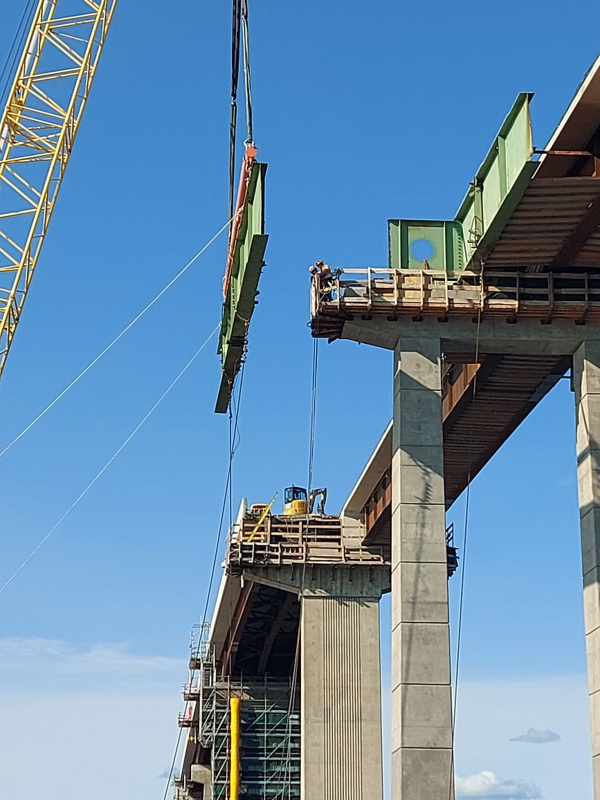 Lowering the first section of the pier 12 hammerhead girder
